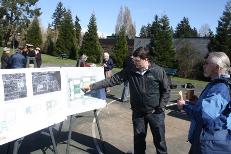 Ethan Fowler/Special to the Kitsap Sun Brandon Keller of PHC Construction, right, goes over the designs for new 5-acre second phase of the Grow Community with real estate agent Keith Hauschulz after Thursday's Government Way decommissioning ceremony.