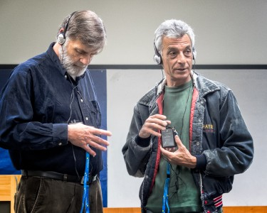 Contributed photo / David Warren Bob Bosserman, left, chair of facilities for Bainbridge Public Library, and Rick Diaz, assistant installer at Now Hear This!, test the newly installed hearing loop in the library's Community Room.