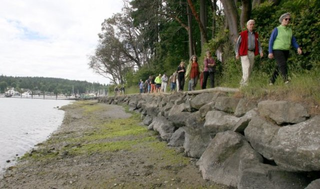 Participants in a city park visioning meeting walk the Waterfront trail in 2013. Photo by TAD SOOTER / KITSAP SUN