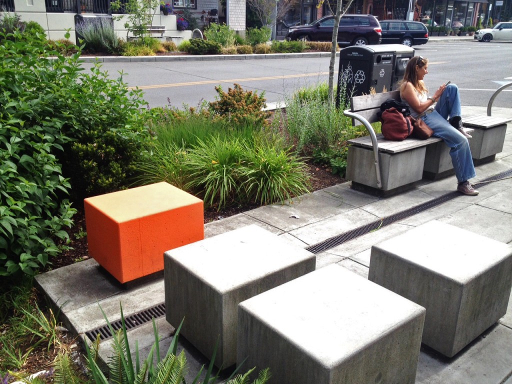 One of the benches that has been painted orange near along Winslow Way. Tristan Baurick/Kitsap Sun