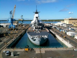 The USS Missouri is seen in Drydock 4, Wednesday, Oct. 14, 2009 at the Pearl Harbor Naval Shipyard, in Pearl Harbor, Hawaii. (AP Photo/The Honolulu Advertiser, Gregory Yamamoto)