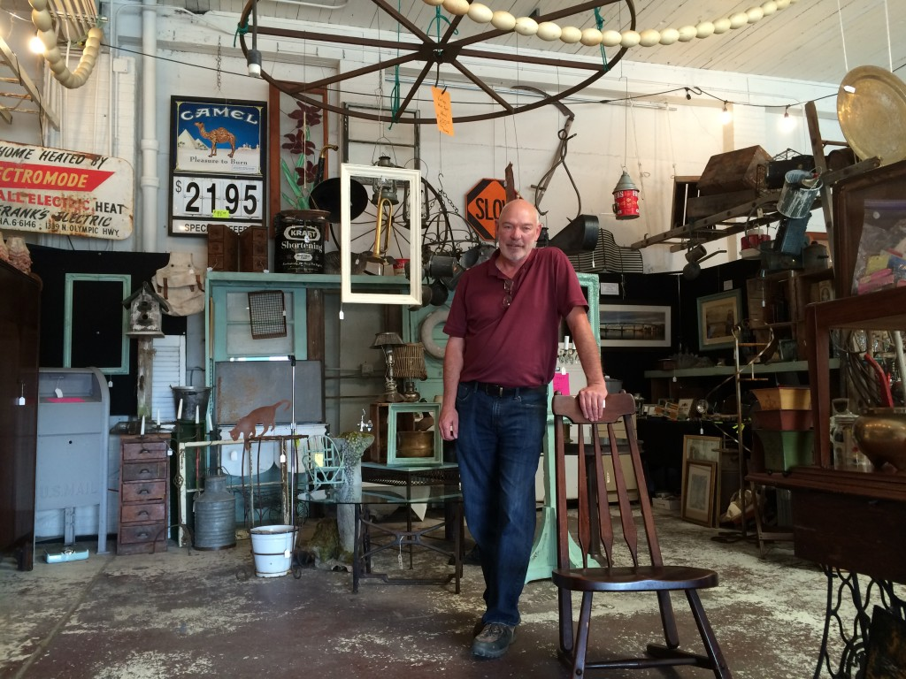 Dick Hausdorf shows off his treasures for sale prior to Saturday's market.