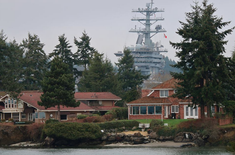 Patrick Kerber took this great shot from South Kitsap, as the Nimitz rolled by some waterfront homes.
