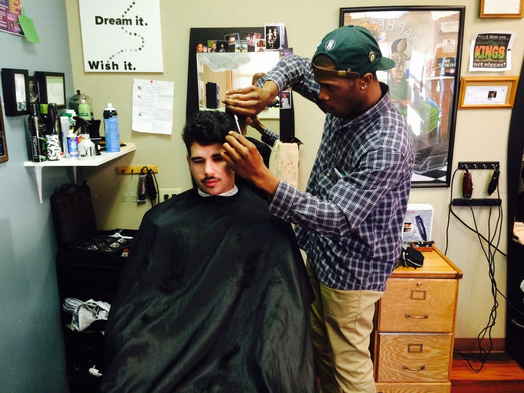 Joshua Adams cuts Jonathan Mendoza's hair.