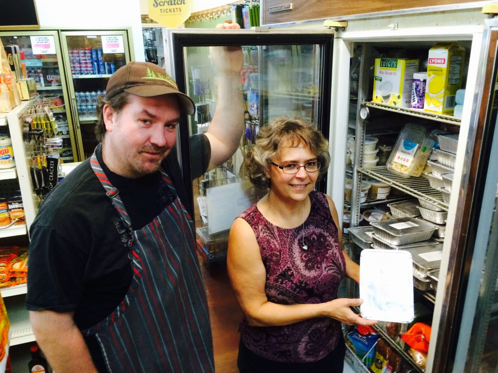 Richard Kost and Cynthia Jeffries in the freezer section.