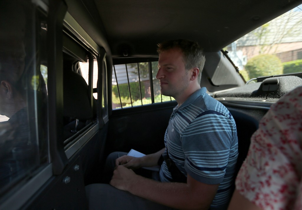 Yes, I have ridden in the back of a cop car. MEEGAN REID / KITSAP SUN