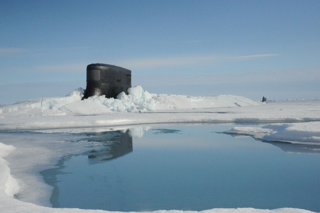150730-N-ZZ999-003 ARCTIC OCEAN (July 30, 2015) The fast attack submarine USS Seawolf (SSN 21) surfaces through Arctic ice at the North Pole. Seawolf conducted routine Arctic operations. (U.S. Navy photo/Released)
