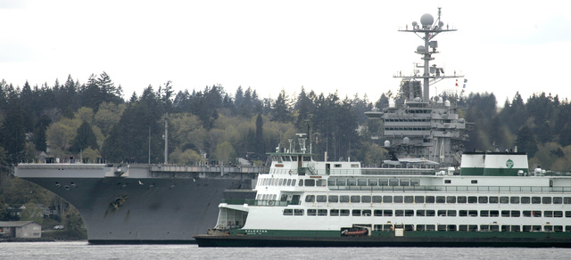 The Washington State auto ferry Kaleetan passes the USS John C. Stennis on Friday. LARRY STEAGALL / KITSAP SUN