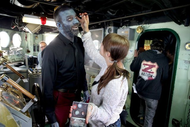 "Keith Allan, who plays Murphy on the show ""Z Nation,"" gets his makeup done aboard the Turner Joy in September. LARRY STEAGALL / KITSAP SUN"