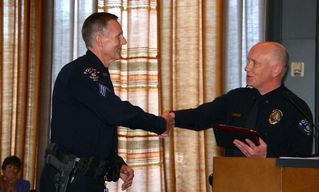 Sergeant Randy Olson (left) is congratulated by Bremerton Police Chief Steve Strachan.