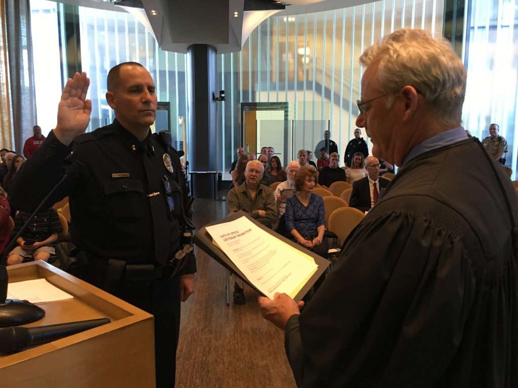 Lt. Mike Davis is sworn in by Bremerton Judge James Docter.