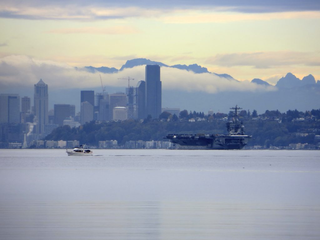 A couple of great shots by Matt King of the Nimitz with Seattle as the backdrop.
