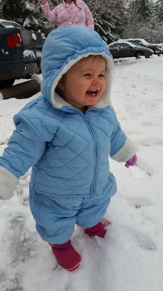 Baby's first snow. Photo by Heather Kimball.