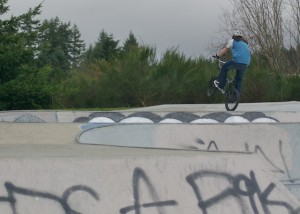 A biker takes a jump at the skate park located in Rotary Gateway Park on Silverdale Way.