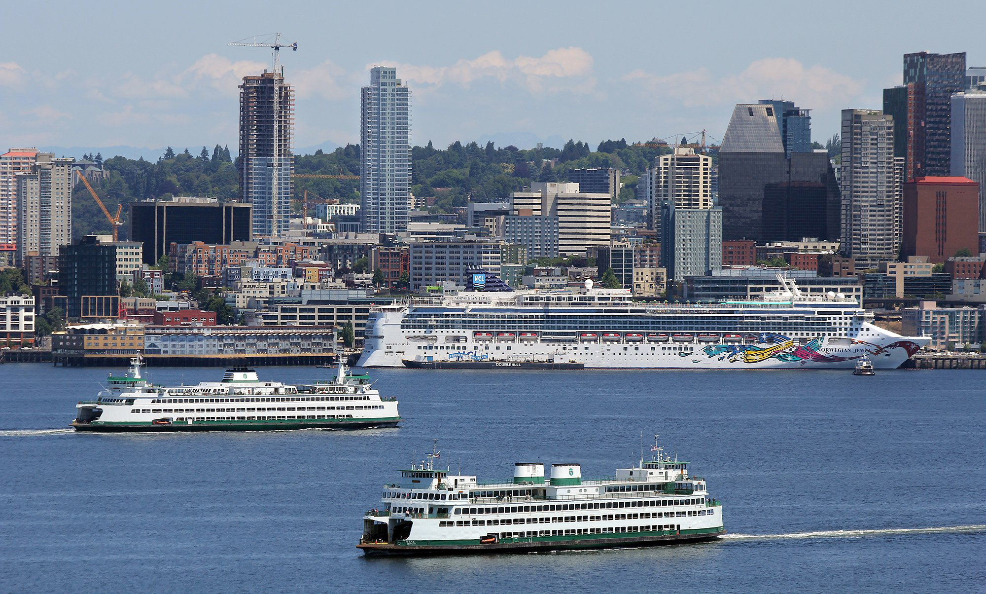 Larry Steagall / Kitsap Sun Lots of big boats, including two ferries and a cruise ship, accent the Seattle scene this weekend under bright skies. Expect more picturesque days this week as forecasts call for sunny skies and highs in the 70s.