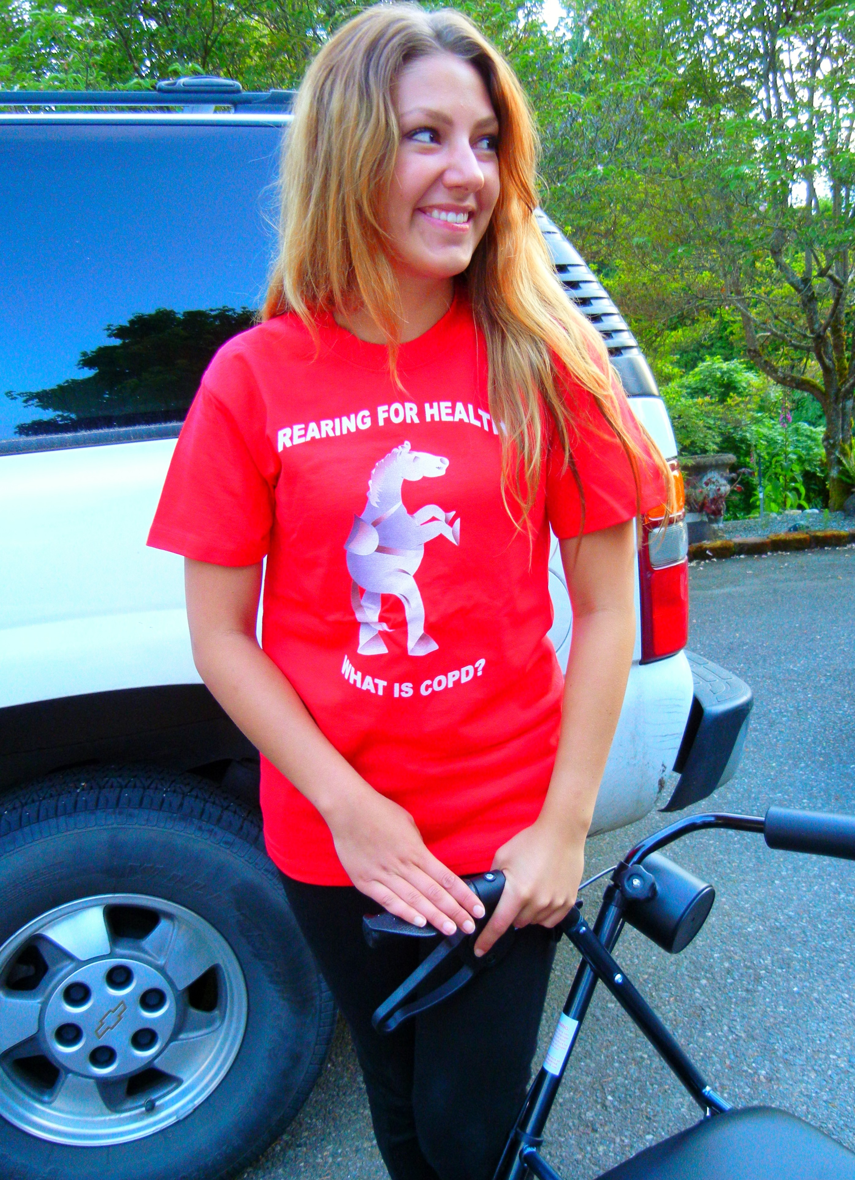 "Our visiting young cousin from Norway rode her first recumbent trike in Silverdale and wore ""What is COPD"" tee shirt while she was here."