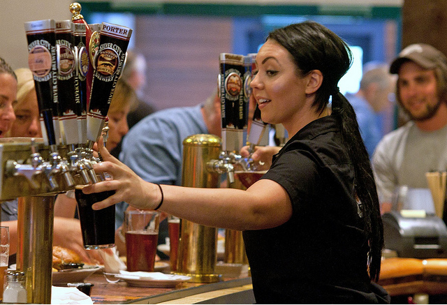 Megan Moran pours two beers for a Tuesday night crowd at Silver City Restaurant and Brewery.