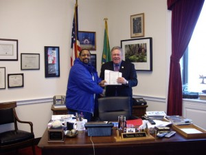 <em>Here from a couple days ago is Jerome Evans, who works at the shipyard, receiving his tickets to the inauguration from U.S. Rep. Norm Dicks, D-Belfair.</em>