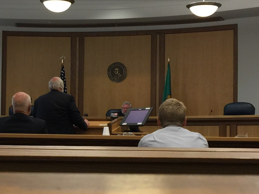 Washington Appeals Court Division II Commissioner Eric Schmidt hears argument s from Dennis Reynolds, attorney for the Kitsap Rifle and Revolver Club.