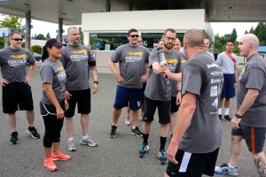 The county team passes the Special Olympics torch to the Bremerton running team consisting of officers and detectives from Bremerton Police Department and cadets from the Washington Youth Academy. Kitsap County Sheriff's Sgt. Jim Porter passes the Special Olympics torch to Bremerton Police Detective Ryan Heffernan, prior to the start of the Bremerton leg of the Law Enforcement Torch Run.
