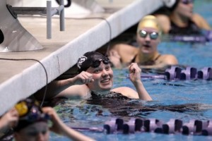 Klahowya's Kelsey Crane was all smiles after winning the 100-yard butterfly at the Class 2A swimming and diving championships at the King County Aquatic Center last November. (LARRY STEAGALL / KITSAP SUN)