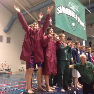 Hunter Parini, front, celebrates along with teammates Tim Gallagher, Ethan Fox and Bryce Hoffer, the Bucs' 200-yard medley relay state championship in the Class 2A meet at KCAC in Federal Way on Saturday. (Annette Griffus | Kitsap Sun)