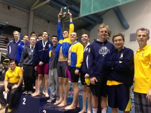 Bainbridge swimmers celebrate their second-place team finish at the Class 3A boys state swimming and diving championships Saturday at KCAC. (Annette Griffus | Kitsap Sun)