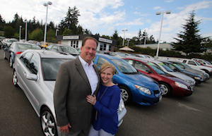 Darrin and Carolyn Hudson at their Hudson Auto lot on Viking Way in Poulsbo on Tuesday, August 20, 2014. (MEEGAN M. REID / KITSAP SUN)