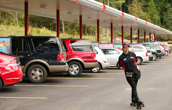 Carhop Cassandra Potts glides across the parking lot at the Sonic in Poulsbo on Wednesday. (MEEGAN M. REID / KITSAP SUN)