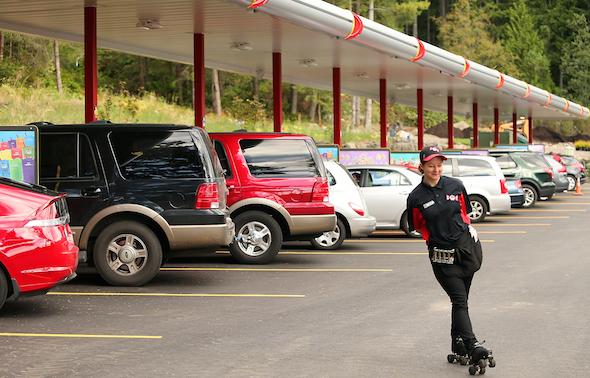 Carhop Cassandra Potts glides across the parking lot at the Sonic in Poulsbo on Wednesday. (MEEGAN M. REID / KITSAP SUN)