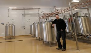 Mora Iced Creamery owner Jerry Perez in the new production facility that is under construction in Poulsbo on Friday, March 27, 2015. (MEEGAN M. REID / KITSAP SUN)