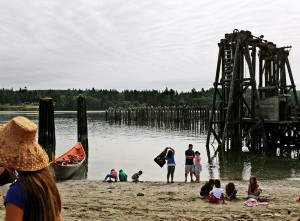 Tribal members and friends gather at the closed mill site in Port Gamble to bless the bay.