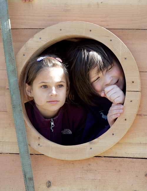 Madrona School Waldorf Eduction third grade students Natalie Taylor,9,left, and Thomas Wyatt,9, look out a port hole on Thursday. Larry Steagall | Kitsap Sun