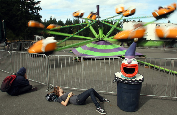 Jamie Milliron, 15, and Robert Jogerst, 15, watch as their friends ride the Octopus at the Kitsap County Fair and Stampede on Friday. MEEGAN M. REID | KITSAP SUN