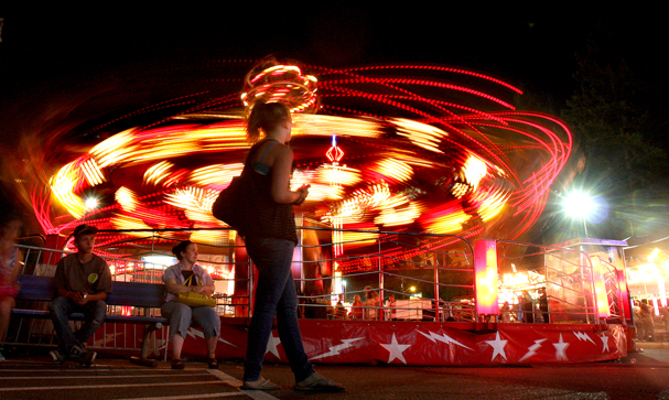 A Davis Amusements / Cascadia ride looks ready to take off Friday night at the Kitsap County Fair and Stampede on the midway. LARRY STEAGALL / KITSAP SUN
