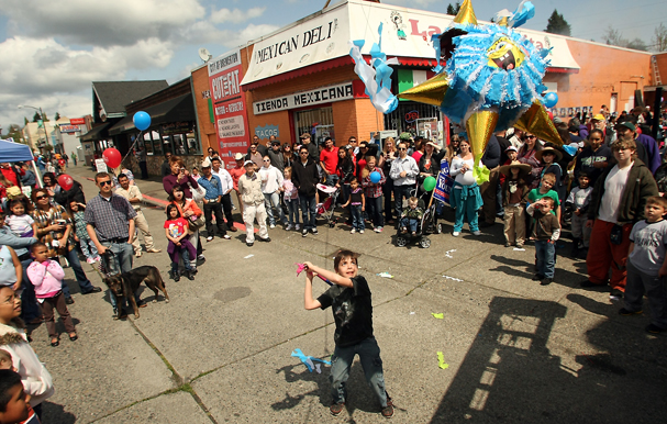 Gavin Rowan, 10, takes a swing at a giant piñata during the Cinco de Mayo Street Fair in Bremerton on Saturday May 05, 2012. (MEEGAN M. REID/KITSAP SUN)