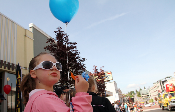 Marli Stodden munches on a dorito as she watches the Armed Forces Day Parade in Bremerton on May 19, 2012. (MEEGAN M. REID / KITSAP SUN)