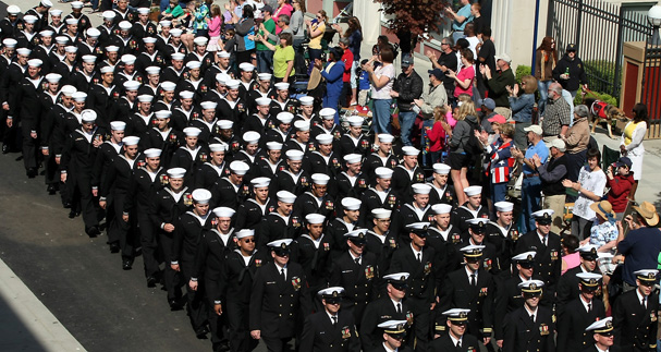 Crew members of the USS Kentucky makes their way down Fourth Street for the Armed Forces Day Parade in Bremerton, Wash. on Saturday, May 19, 2012. (AP Photo/Kitsap Sun, Meegan M. Reid)