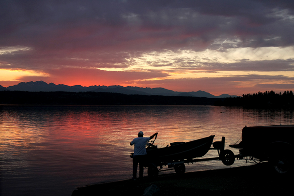 A small boat is hooked up to a trailer at the Tracyton Boat Ramp on Thursday during sunset. (LARRY STEAGALL / KITSAP SUN)