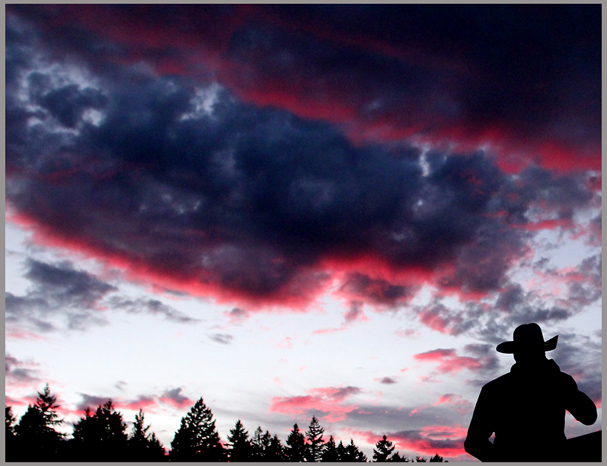 A cowboy is silhouetted against the sky during the first night of the Kitsap County Stampede on Wednesday. (MEEGAN M. REID)