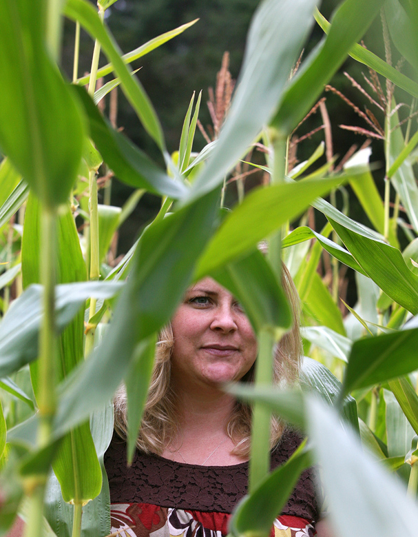 Bandy Williams of Silverdale walks thru the corn maze for the first time at the Pheasant Fields Farm in Silverdale. (LARRY STEAGALL / KITSAP SUN)