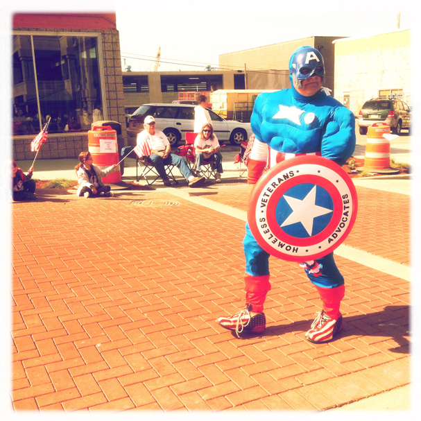 """Captain America Patrols Parade Route"" by Meegan M. Reid"