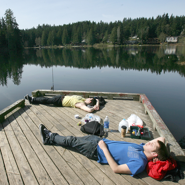 Taylor Feld and Sperry Mullins have a lazy day in the sun fishing at Island Lake County Park. (LARRY STEAGALL / KITSAP SUN)_