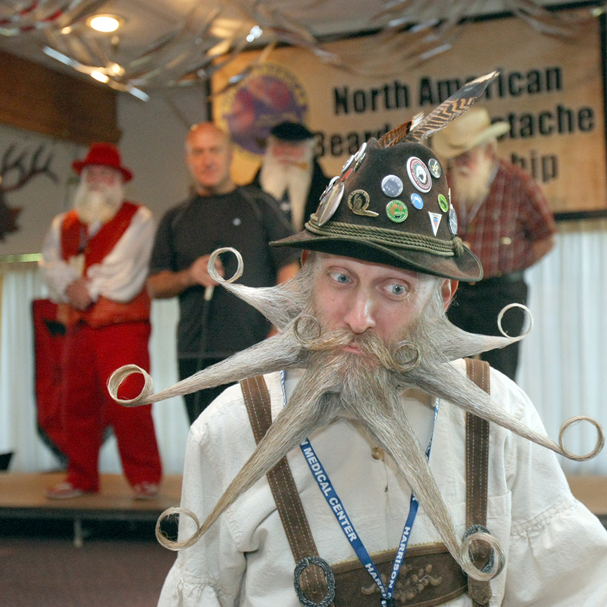 Aarne Bielefeldt from California gets close to the judges at the North American Beard and Mustache Championships at the Bremerton Elks Lodge. He scored a perfect score and won first place in the freestyle category. (LARRY STEAGALL / KITSAP SUN)
