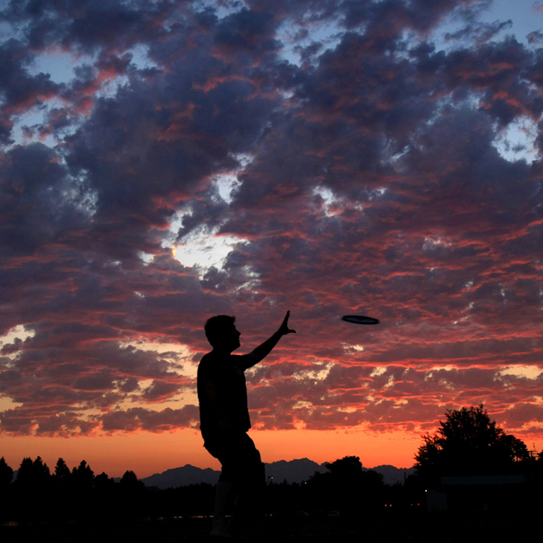 Colin Potter of Bremerton plays frisbee at Lions Park in Bremerton at sunset. (LARRY STEAGALL / KITSAP SUN)