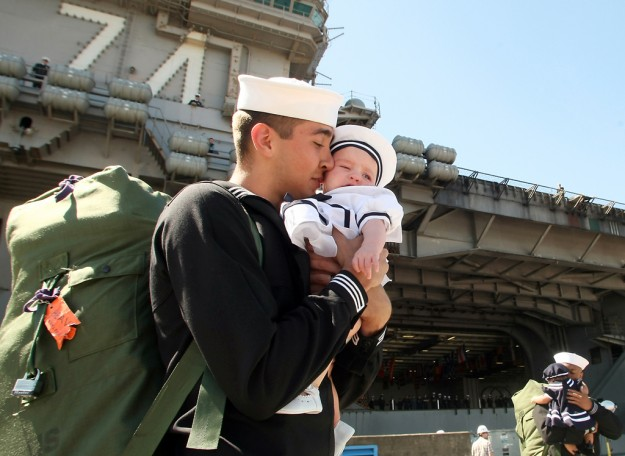 Jacob James nuzzles his 5-month-old daughter Annabelle after arriving on the USS John C. Stennis at Naval Base Kitsap-Bremerton on Friday, May, 3, 2013. (MEEGAN M. REID / KITSAP SUN)