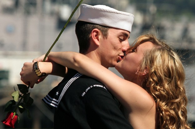Sailor Brandon Rimes kisses his wife Sam after the couple were reunited on the pier after the USS John C. Stennis docked at Naval Base Kitsap-Bremerton on Friday, May, 3, 2013. (MEEGAN M. REID / KITSAP SUN)