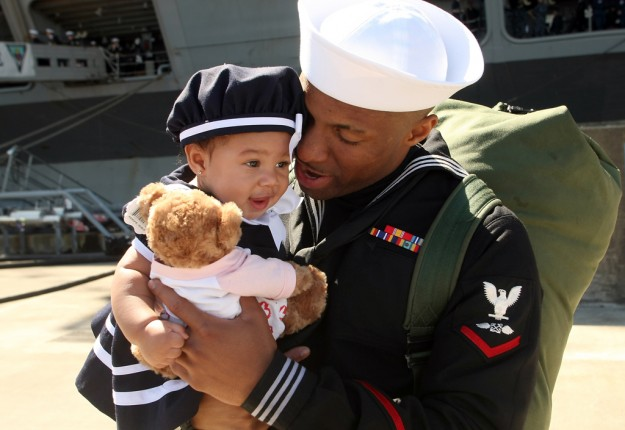 Jason Griffin holds his 6-month-old daughter Jordynn for the first time after the USS John C. Stennis docked at Naval Base Kitsap-Bremerton in Bremerton, Wash. on Friday, May 3, 2013. (AP PHOTO/ Kitsap Sun, Meegan M. Reid)
