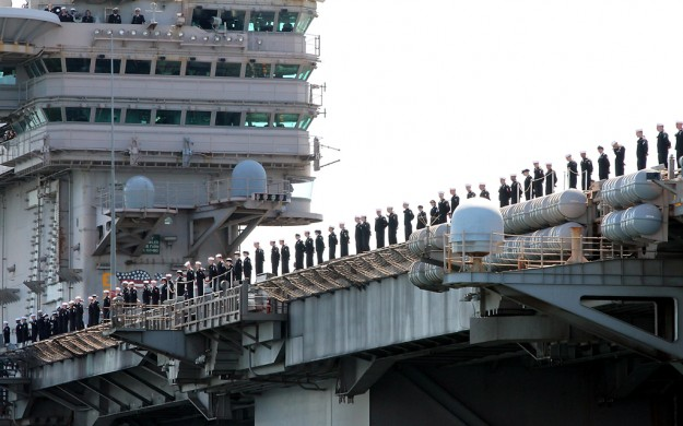 Sailors man the rails as the USS John C. Stennis docks at Naval Base Kitsap-Bremerton on Friday, May, 3, 2013. (MEEGAN M. REID / KITSAP SUN)