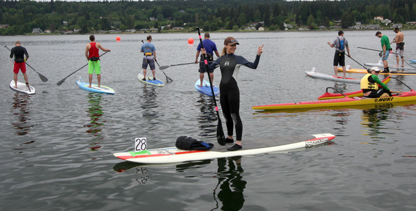 Bonnie Ogilvie was the only woman that entered the 5 mile paddle board race held Sunday, the final day of the Viking Festival in Poulsbo. (STEVE ZUGSCHWERDT / SPECIAL TO THE KITSAP SUN)